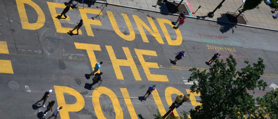 """""""Defund the police"""" is painted on the street near the White House"""