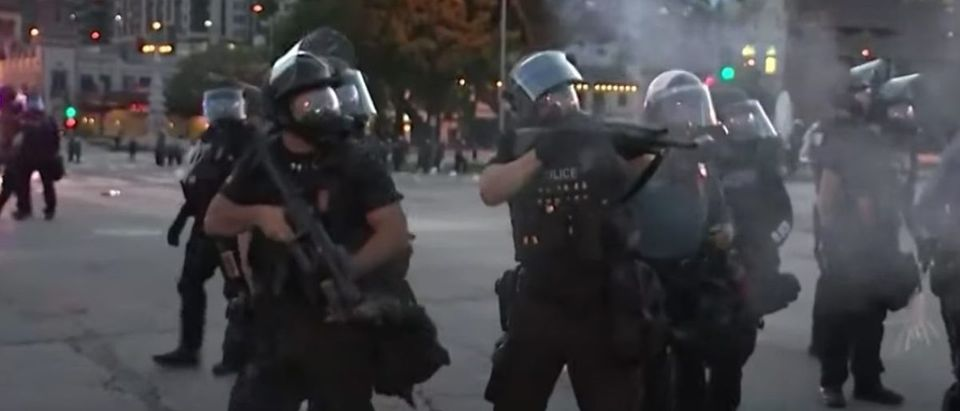 Kansas City Police Department officers fire tear gas to disperse crowds at George Floyd protest, May 31, 2020. (YouTube screen capture/KCTV)