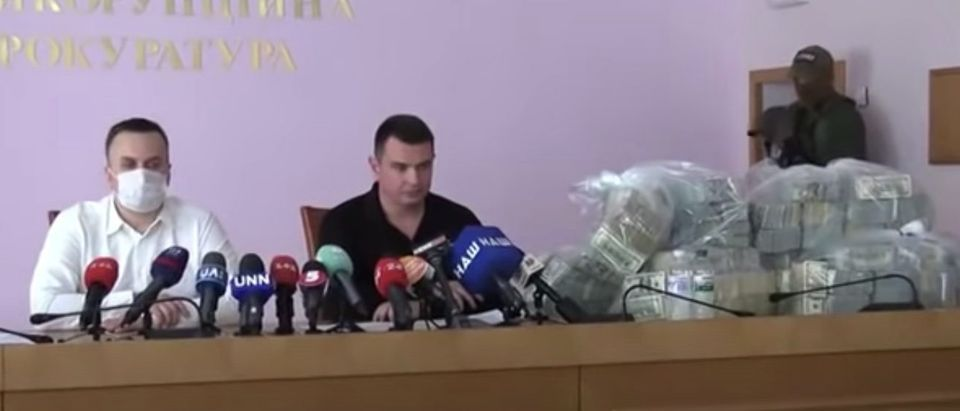 Artem Sytnyk and Nazar Kholodnytsky of Ukraine's National Anti-Corruption Bureau announce that $6 million was uncovered in an attempted bribe related to Burisma Holdings. June 13, 2020. (YouTube screen capture/NABU)