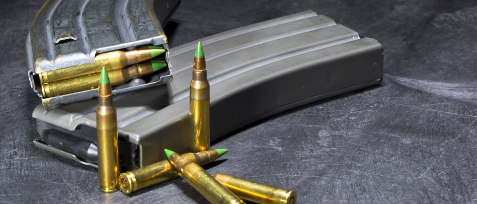 Metal AR-15 magazines and steel-core green tip ammunition (Grindstone Media Group /Shutterstock)