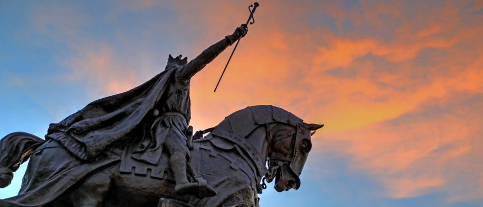 July 7, 2017 - St. Louis, Missouri - The sunset over the Apotheosis of St. Louis statue of King Louis IX of France in Forest Park, St. Louis, Missouri. (Photo by ShutterStocker/STJLB)