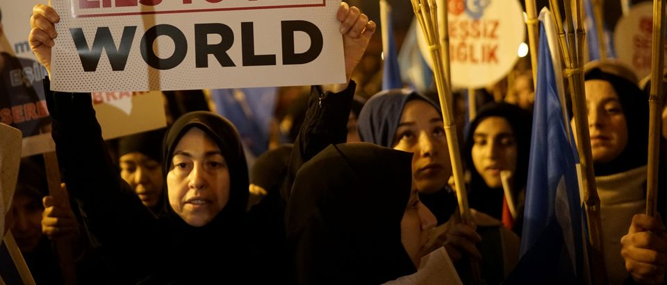 Protesters march in support of China's Uighurs and in solidarity with Arsenal midfielder Mesut Ozil after the furore caused by his criticism of China's policies toward the Muslim minority in Istanbul