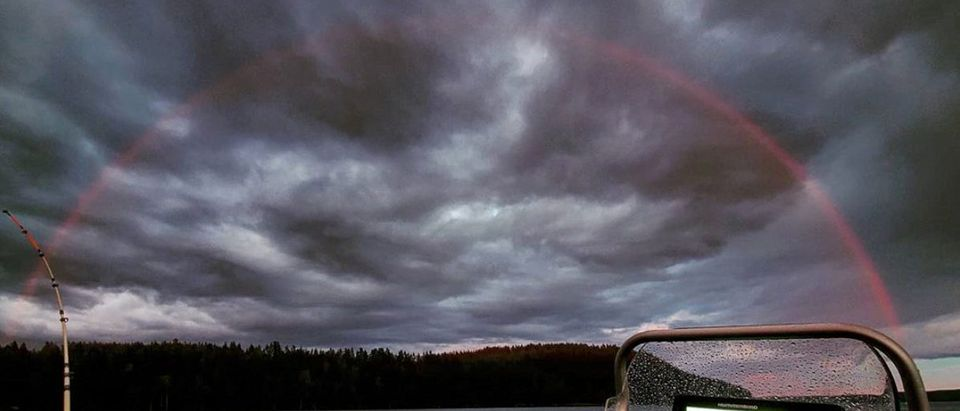 A red rainbow is seen off the shore of Paijanne Lake in Finland