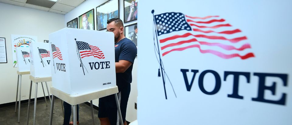 Voters cast their ballots for Early Voting at the Los Angeles County Registrar's Office in Norwalk, California on November 5, 2018, a day ahead the November 6 midterm elections in the United States. (Photo by Frederic J. Brown/AFP via Getty Images)
