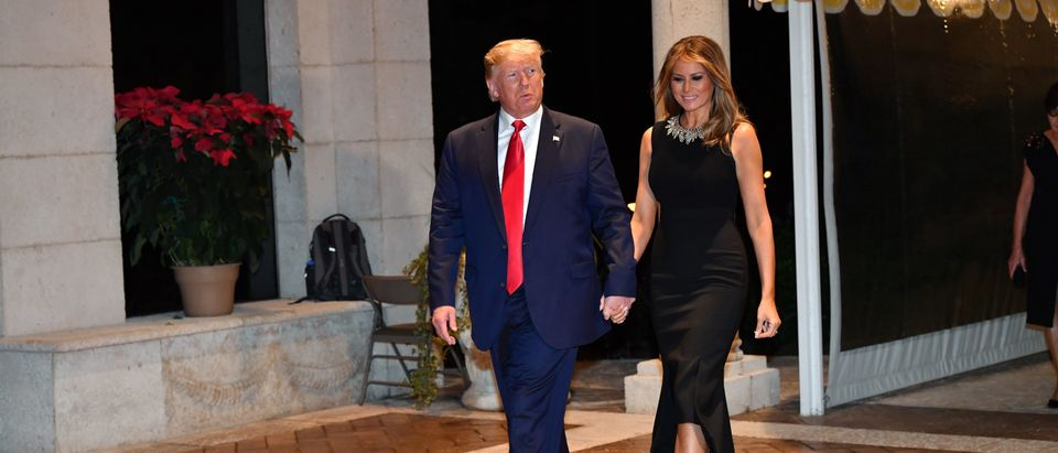 US President Donald Trump and First Lady Melania Trump arrive for a Christmas Eve dinner with his family at Mar-A-Lago in Palm Beach, Florida on December 24, 2019. (Photo by NICHOLAS KAMM/AFP via Getty Images)