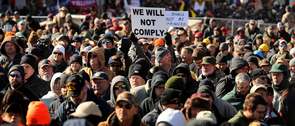 RICHMOND, VIRGINIA - JANUARY 20: Thousands of gun rights advocates attend a rally organized by The Virginia Citizens Defense League on Capitol Square near the state capital building January 20, 2020 in Richmond, Virginia. During elections last year, Virginia Governor Ralph Northam promised to enact sweeping gun control laws in 2020, including limiting handgun purchase to one per month, banning military-style weapons and silencers, allowing localities to ban guns in public spaces and enacting a 'red flag' law so authorities can temporarily seize weapons from someone deemed a threat. While event organizers have asked supporters to show up un-armed, militias and other extremist groups from across the country plan to attend the rally and show their support for gun rights. (Photo by Chip Somodevilla/Getty Images)