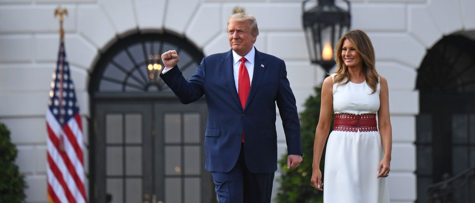 "US President Donald Trump and First Lady Melania Trump arrive to host the 2020 ""Salute to America"" event in honor of Independence Day on the South Lawn of the White House in Washington, DC, July 4, 2020. (Photo by SAUL LOEB/AFP via Getty Images)"