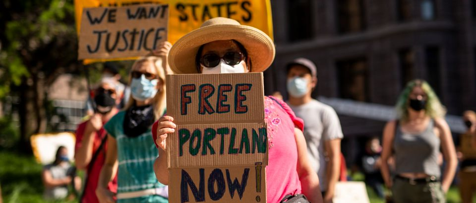 Protestors In Minneapolis Rally Against Federal Law Enforcement In U.S. Cities