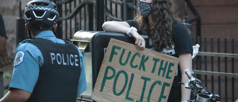 CHICAGO, ILLINOIS - JULY 10: Chicago police prevent demonstrators from reaching the private residence of Illinois Governor J.B. Pritzker on July 10, 2020 in Chicago, Illinois. Demonstrators stage a protest against police torture and demanded for Governor Pritzker to release all police torture survivors and the wrongfully convicted. (Photo by Scott Olson/Getty Images)
