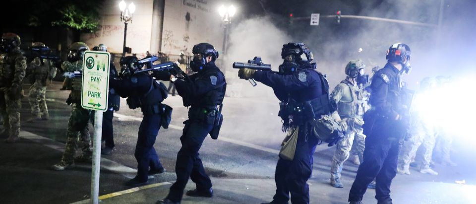 PORTLAND, OREGON - JULY 27: Federal police face off with protesters in front of the Mark O. Hatfield federal courthouse in downtown Portland as the city experiences another night of unrest on July 27, 2020 in Portland, Oregon. For over 57 straight nights, protesters in downtown Portland have faced off in often violent clashes with the Portland Police Bureau and, more recently, federal officers. The demonstrations began to honor the life of George Floyd and other black Americans killed by law enforcement and have intensified as the Trump administration called in the federal officers. (Spencer Platt/Getty Images)