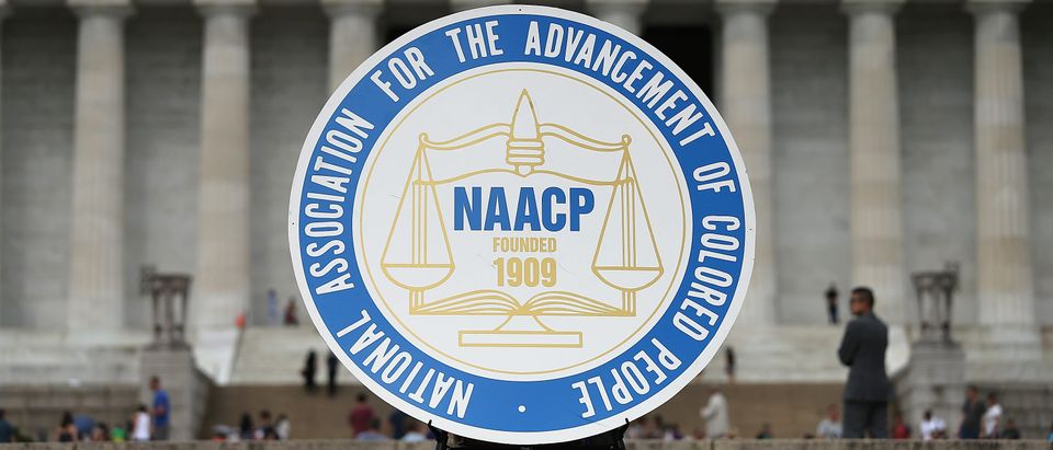 "A logo is seen for the National Association for the Advancement of Colored People as NAACP President and CEO Cornell William Brooks speaks during a press conference at the Lincoln Memorial June 15, 2015 in Washington, DC. Brooks announced ""America's Journey for Justice,"" an 860-mile march from Selma, Alabama to Washington, D.C. and a campaign ""to protect the right of every American to a fair criminal justice system, uncorrupted and unfettered access to the ballot box, sustainable jobs with a living wage, and equitable public education."" (Photo by Win McNamee/Getty Images)"