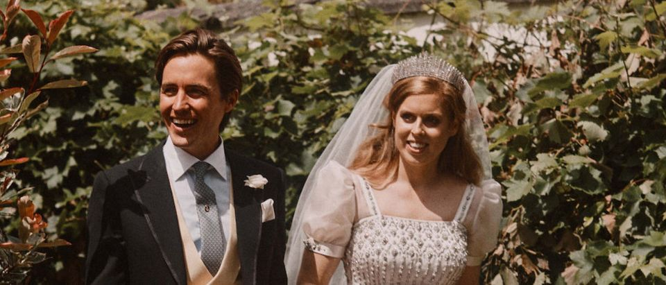 Britain's Princess Beatrice and Edoardo Mapelli Mozzi are seen in the grounds of the Royal Lodge after their wedding, in Windsor, Britain, in this official wedding photograph released by the Royal Communications on July 19, 2020. Benjamin Wheeler/Pool via REUTERS