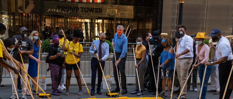 "New York City Mayor Bill de Blasio, his wife Chirlane McCray and Rev. Al Sharpton help paint a Black Lives Matter mural on Fifth Avenue directly in front of Trump Tower on July 9, 2020 in New York City. In a tweet, President Trump called the mural a ""symbol of hate"" and said that it would be ""denigrating this luxury Avenue"". (Photo by David Dee Delgado/Getty Images)"