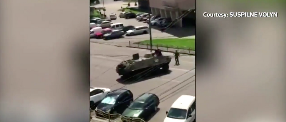 A video shows the confrontation between a Ukrainian man who has taken 20 people hostage on a bus Tuesday and a tank.[Twitter/Screenshot/Public — User: Reuters]