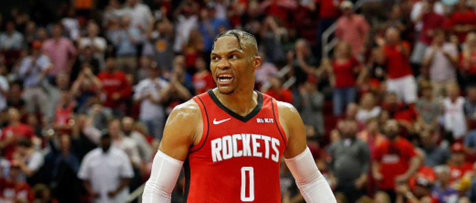 HOUSTON, TX - OCTOBER 24: Russell Westbrook #0 of the Houston Rockets reacts after a dunk in the second half against the Milwaukee Bucks at Toyota Center on October 24, 2019 in Houston, Texas. NOTE TO USER: User expressly acknowledges and agrees that, by downloading and or using this photograph, User is consenting to the terms and conditions of the Getty Images License Agreement. (Photo by Tim Warner/Getty Images)