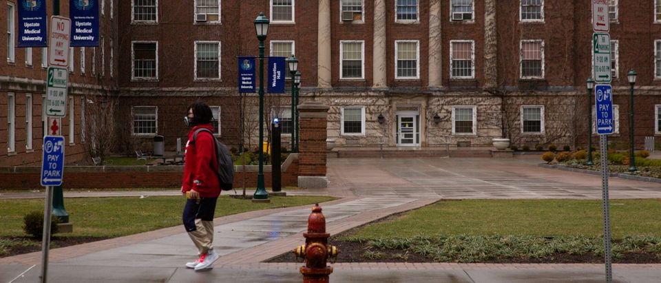 A student wears a protective mask at Syracuse University