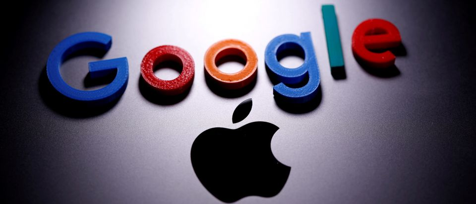A 3D printed Google logo is placed on the Apple Macbook in this illustration