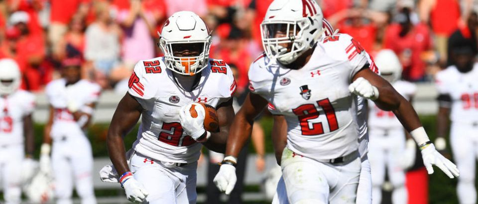 ATHENS, GA - SEPTEMBER 1: Prince Momodu #22 of the Austin Peay Governors carries the ball behind blocking by Ahmaad Tanner #21 during the game against the Georgia Bulldogs on September 1, 2018 in Athens, Georgia. (Photo by Scott Cunningham/Getty Images)