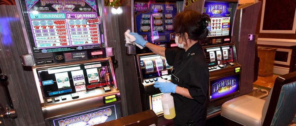LAS VEGAS, NEVADA - JUNE 01: A worker sanitizes slot machines in a high-limit room for slots at Bellagio Resort & Casino as the Las Vegas Strip property, which has been closed since March 17 in response to the coronavirus pandemic, prepares to reopen on June 1, 2020 in Las Vegas, Nevada. Hotel-casinos throughout the state will be able to reopen on June 4 as part of a phased reopening of the economy with social distancing guidelines and other restrictions in place. MGM Resorts International plans to reopen Bellagio, New York-New York Hotel & Casino, MGM Grand Hotel & Casino and The Signature on Thursday. (Photo by Ethan Miller/Getty Images)