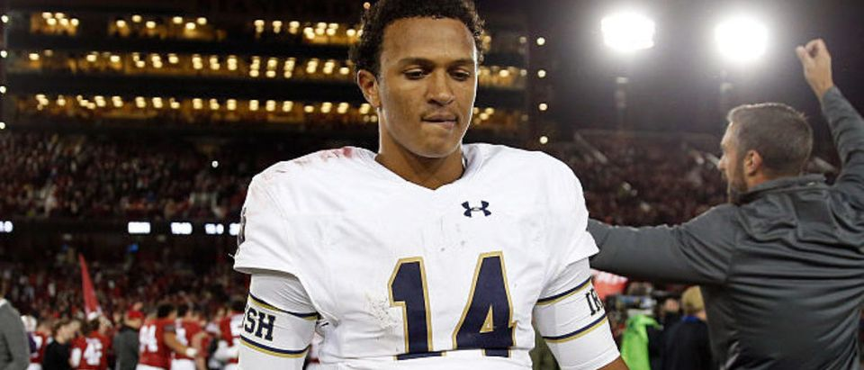 PALO ALTO, CA - NOVEMBER 28: DeShone Kizer #14 of the Notre Dame Fighting Irish walks off the field after they lost to the Stanford Cardinal on a last-second field goal at Stanford Stadium on November 28, 2015 in Palo Alto, California. (Photo by Ezra Shaw/Getty Images)