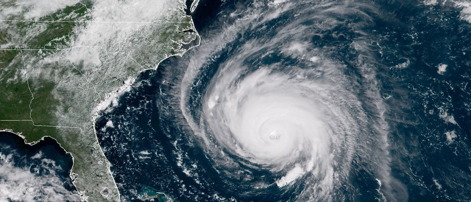 In this satellite image provided by U.S. National Oceanic and Atmospheric Administration (NOAA), Hurricane Florence churns through the Atlantic Ocean toward the U.S. East Coast on September 12, 2018. Florence slowed its approach to the U.S. today and was forecast to turn south, stalling along the North Carolina and South Carolina coast and bringing with it torrential rain, high winds and a dangerous storm surge tomorrow through Saturday. (Photo by NOAA via Getty Images)