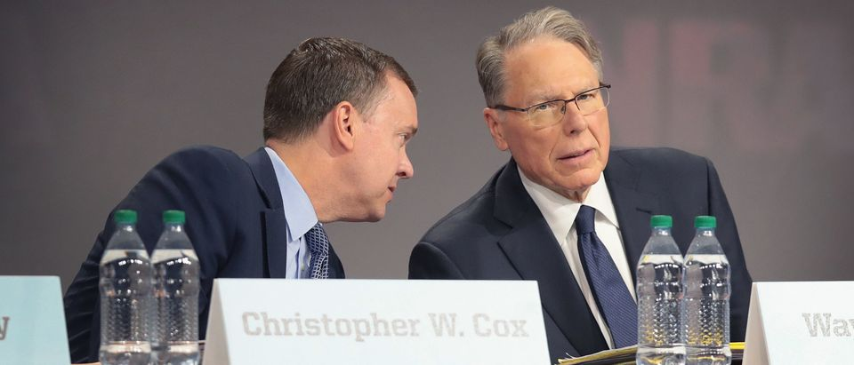 INDIANAPOLIS, INDIANA - APRIL 27: Chris Cox (L), executive director of the NRA-ILA, and Wayne LaPierre, NRA vice president and CEO attend the NRA annual meeting of members at the 148th NRA Annual Meetings & Exhibits on April 27, 2019 in Indianapolis, Indiana. A statement was read at the meeting announcing that NRA president Oliver North, whose seat at the head table remained empty at the event, would not serve another term. There have been recent reports of tension between LaPierre and North, with North citing financial impropriety within the organization. (Scott Olson/Getty Images)