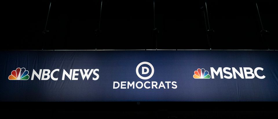 Advertising signage for NBC News and the Democratic Party is seen inside the media filing center at Adrienne Arsht Center for the Performing Arts where the first Democratic presidential primary debates for the 2020 elections will take place, June 25, 2019 in Miami, Florida. (Drew Angerer/Getty Images)