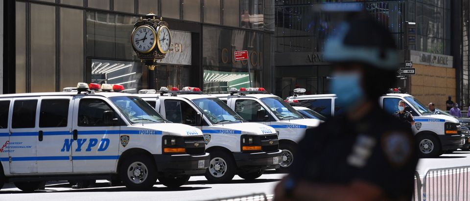 A NYPD officer stands guard on 5th Avenue at Trump Tower during a protest against police brutality and racial inequality in the aftermath over the death of George Floyd on June 12, 2020 in New York City. - Demonstrations are being held across the US following the death of George Floyd on May 25, 2020, while being arrested in Minneapolis, Minnesota. (ANGELA WEISS/AFP via Getty Images)