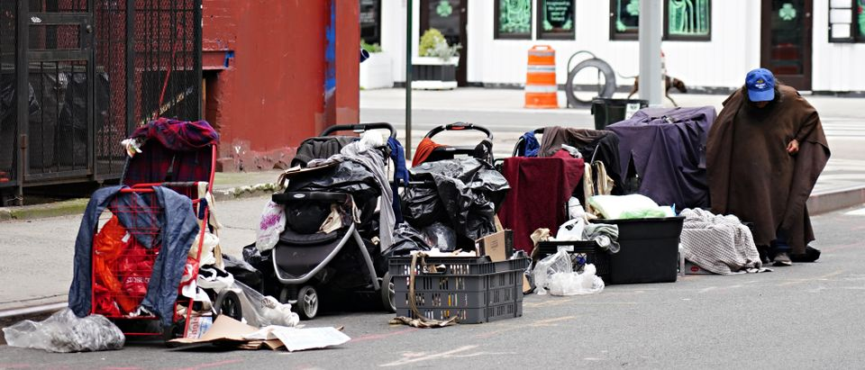 NEW YORK, NEW YORK - MAY 24: A homeless person sits with their belongings on the street during the coronavirus pandemic on May 24, 2020 in New York City. COVID-19 has spread to most countries around the world, claiming over 343,000 lives with over 5.3 million infections reported. (Cindy Ord/Getty Images)