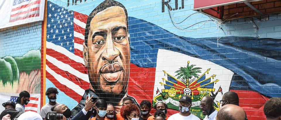 Terrance Floyd (R in baseball cap), the brother of George Floyd, attends a unveiling of a mural painted by artist Kenny Altidor depicting George Floyd on a sidewall of CTown Supermarket on July 13, 2020 in the Brooklyn borough New York City. (Stephanie Keith/Getty Images)