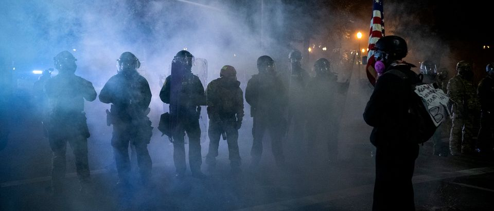 Federal law enforcement dispense tear gas as they confront demonstrators during a night of protest against racial injustice, police brutality and the deployment of federal troops to US cities on July 29, 2020 in Portland, Oregon. - Protests in the US city of Portland have continued for more than 60 days. President Donald Trump's administration on July 29 agreed to a deal to defuse weeks of clashes with the withdrawal of federal forces whose presence enraged protesters, but the timing remained in dispute. (Photo by Alisha Jucevic/AFP via Getty Images)
