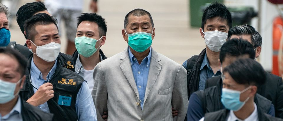 Hong Kong media tycoon and Apple Daily founder Jimmy Lai (C) is escorted by the police to the Royal Hong Kong Yacht Club Shelter Cove Clubhouse for evidence collection as part of the ongoing investigations on August 11, 2020 in Hong Kong, China. (Anthony Kwan/Getty Images)