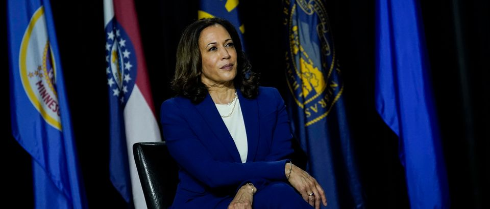 Democratic presidential candidate former Vice President Joe Biden's running mate Sen. Kamala Harris (D-CA) listens to Biden make remarks at the Alexis Dupont High School on August 12, 2020 in Wilmington, Delaware. (Drew Angerer/Getty Images)