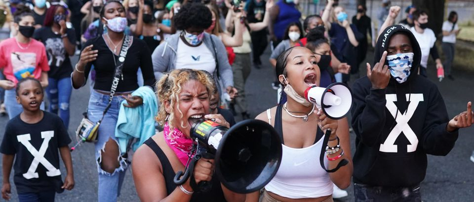 Erandi, center left, and Oria B, center right, two protest organizers who declined to give their last names, lead a peaceful march against racial injustice and police brutality on August 20, 2020 in Portland, Oregon. (Nathan Howard/Getty Images)