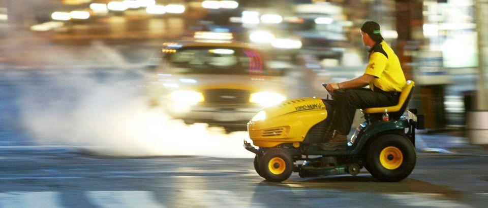 """Yard Man"" Rides Lawnmower Cross Country"