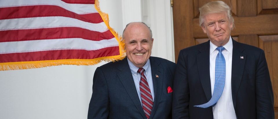 President-elect Donald Trump meets with former New York City Mayor Rudy Giuliani at the clubhouse of Trump National Golf Club November 20, 2016 in Bedminster, New Jersey. / AFP / Don EMMERT (Photo credit should read DON EMMERT/AFP via Getty Images)