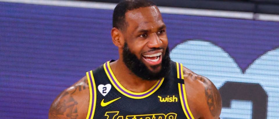 LAKE BUENA VISTA, FLORIDA - AUGUST 24: LeBron James #23 of the Los Angeles Lakers reacts after hitting a three point basket against the Portland Trail Blazers in Game Four of the Western Conference First Round during the 2020 NBA Playoffs at AdventHealth Arena at ESPN Wide World Of Sports Complex on August 24, 2020 in Lake Buena Vista, Florida. (Photo by Kevin C. Cox/Getty Images)