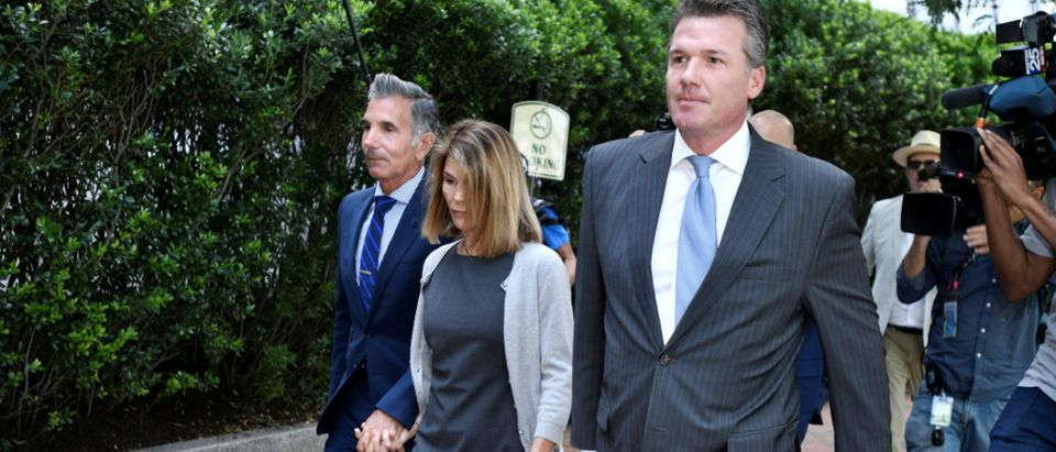 Actress Lori Loughlin and her husband fashion designer Mossimo Giannulli arrive at the federal courthouse in Boston