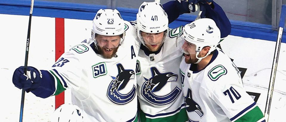EDMONTON, ALBERTA - AUGUST 25: Alexander Edler #23, Elias Pettersson #40 and Tanner Pearson #70 of the Vancouver Canucks celebrate a goal against the Vegas Golden Knights during the third period in Game Two of the Western Conference Second Round during the 2020 NHL Stanley Cup Playoffs at Rogers Place on August 25, 2020 in Edmonton, Alberta, Canada. (Photo by Bruce Bennett/Getty Images)
