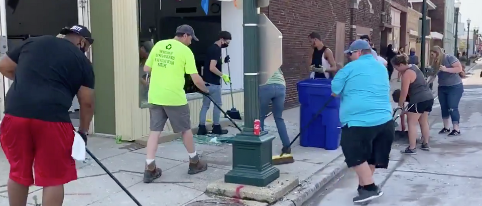 Residents of Kenosha, Wisconsin came out to clean up the city after a night of rioting. (Screenshot Twitter Shelby Talcott)