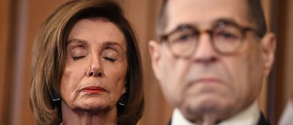 Speaker of the House Nancy Pelosi (L) and House Judiciary Chairman Jerry Nadlerlisten as Democrats announced articles of impeachment against US President Donald Trump during a press conference at the US Capitol in Washington, DC