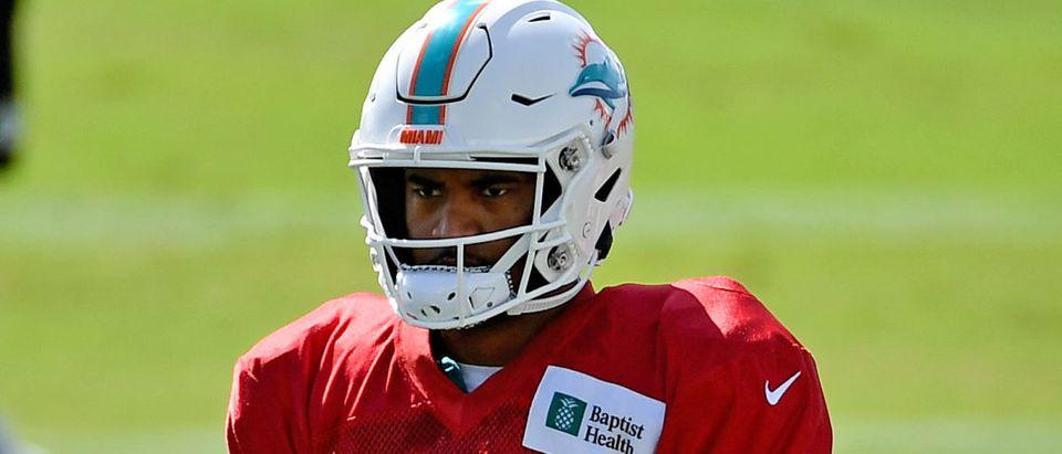 Aug 18, 2020; Miami Gardens, Florida, USA; Miami Dolphins quarterback Tua Tagovailoa (1) stands on the field during training camp at Baptist Health Training Facility. Mandatory Credit: Jasen Vinlove-USA TODAY Sports via Reuters
