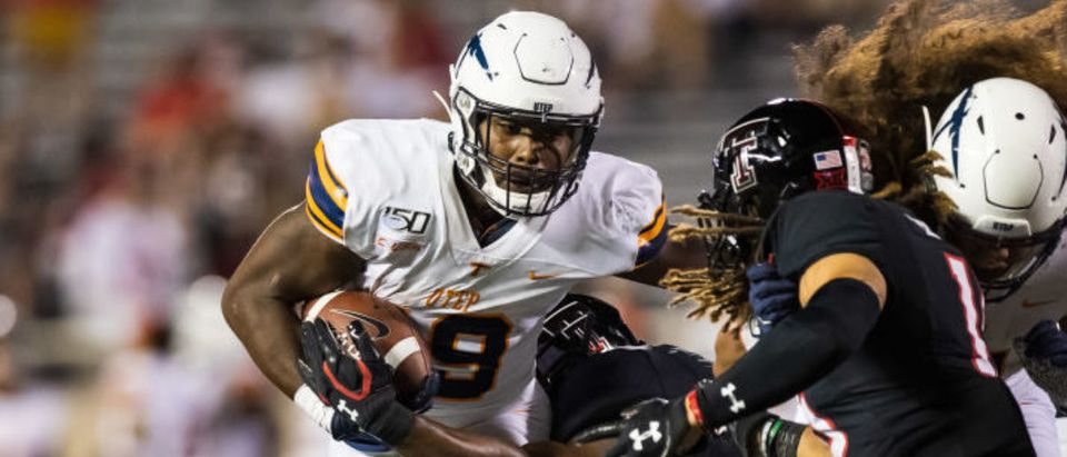 LUBBOCK, TEXAS - SEPTEMBER 07: Running back Treyvon Hughes #9 of UTEP is tackled during the second half of the college football game between the Texas Tech Red Raiders and the UTEP Miners at Jones AT&T Stadium on September 07, 2019 in Lubbock, Texas. (Photo by John E. Moore III/Getty Images)