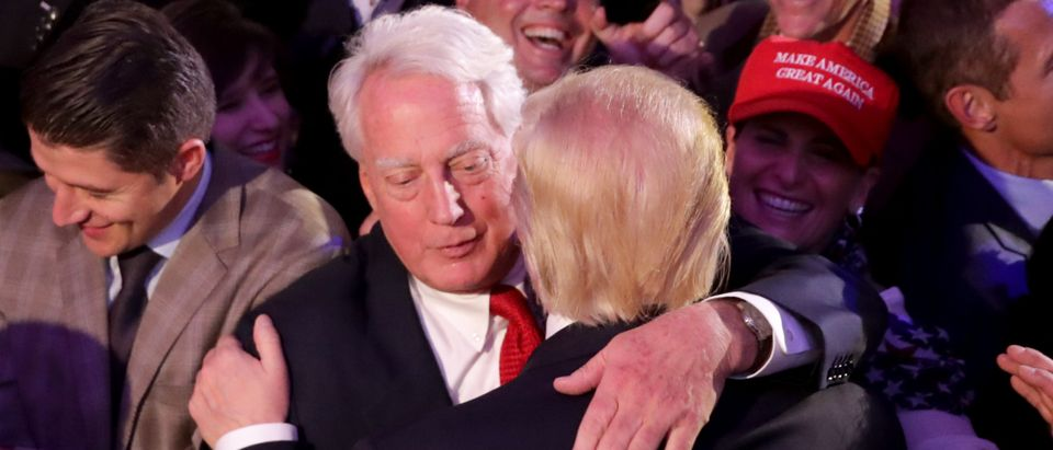 Republican president-elect Donald Trump (R) hugs his brother Robert Trump after delivering his acceptance speech. Chip Somodevilla/Getty Images