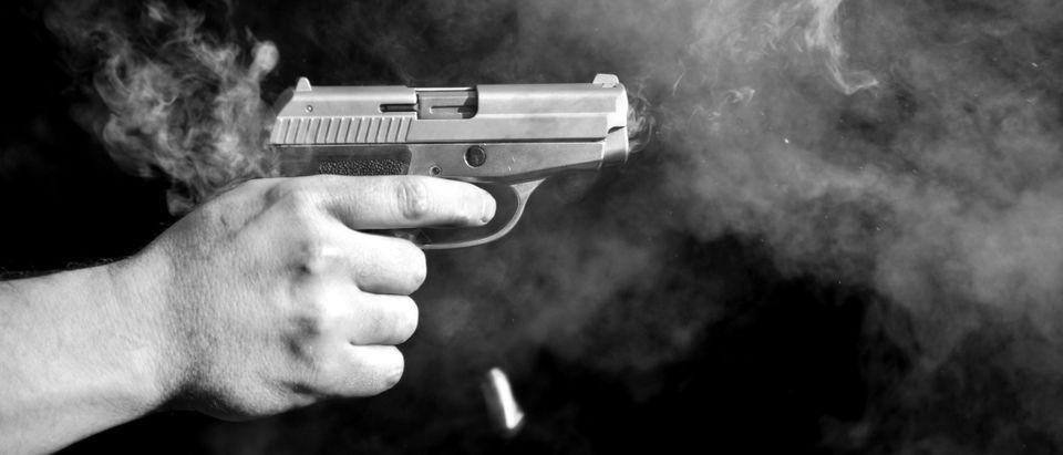 Handgun firing (csabacz/Shutterstock)