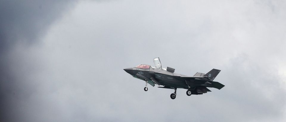 A U.S. Marine Corps F-35B Joint Strike Fighter hover during an aerial display at the Singapore Airshow in Singapore