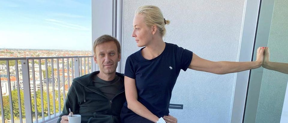 Russian opposition politician Navalny and his wife Navalnaya pose for a picture at Charite hospital in Berlin