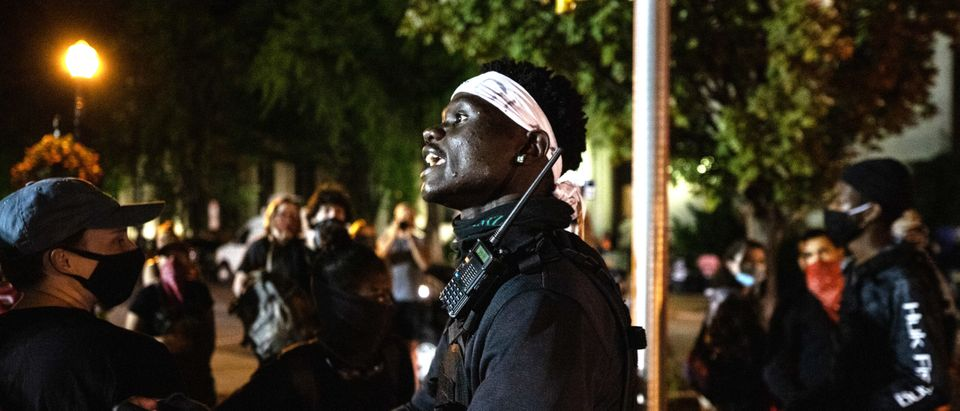 A protester warns others about arrests being made by police on Monday, Sept. 14, 2020 in Lancaster, PA. (Kaylee Greenlee, Daily Caller News Foundation)