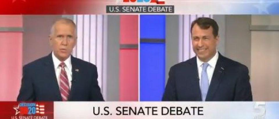 Cal Cunningham laughs during debate (Twitter screengrab)