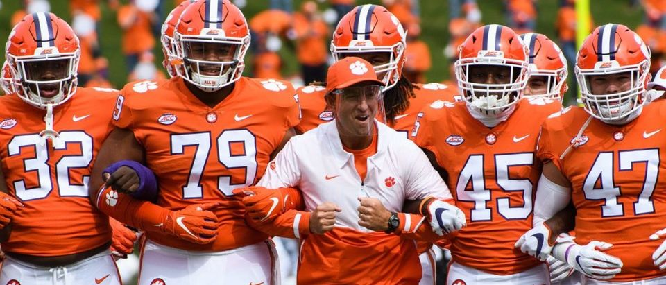 Sep 19, 2020; Clemson, SC, USA; Clemson head coach Dabo Swinney walks with his players during the walk of champions before their game against The Citadel on Saturday, Sept. 19, 2020. Mandatory Credit: Ken Ruinard/Greenville News-USA TODAY NETWORK via Reuters